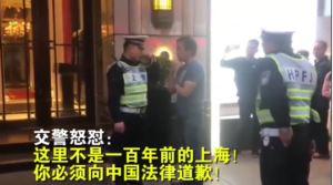 日男违规过马路沪警:这不是100年前向中国法律道歉