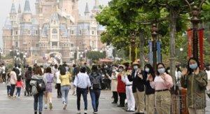 聚焦:上海迪士尼限流重开 全球各地探索走出困境