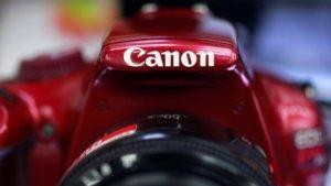 Canon公布季报来首见亏损上半年股利砍半